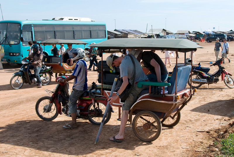 Fellow travelers taking a tuk-tuk to town