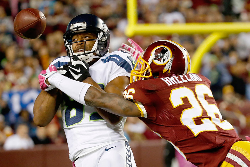. Washington Redskins strong safety Bashaud Breeland (26) breaks up a pass intended for Seattle Seahawks wide receiver Doug Baldwin (89) during the first half of an NFL football game in Landover, Md., Monday, Oct. 6, 2014. (AP Photo/Alex Brandon)