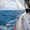 View from on board a luxury sailboat sailing through the tropics.