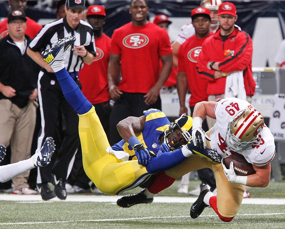 . St. Louis Rams outside linebacker Rocky McIntosh collides with San Francisco 49ers fullback Bruce Miller during the first half of their NFL football game in St. Louis, Missouri, December 2, 2012. REUTERS/Sarah Conard