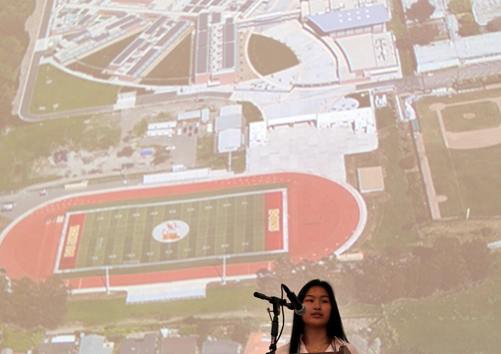 . Iris Wong, 17, student body president at De Anza High School, speaks during a dedication ceremony for the school\'s new campus in Richmond, Calif., on Saturday, Sept. 7, 2013. This is the latest school reconstruction project in the West Contra Costa school district. (Anda Chu/Bay Area News Group)