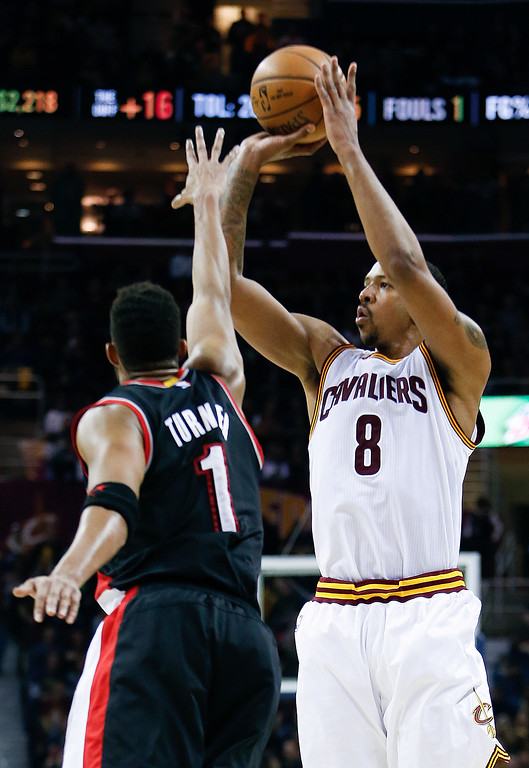 . Cleveland Cavaliers\' Channing Frye (8) shoots over Portland Trail Blazers\' Evan Turner (1) during the first half of an NBA basketball game, Wednesday, Nov. 23, 2016, in Cleveland. The Cavaliers won 137-125. (AP Photo/Ron Schwane)