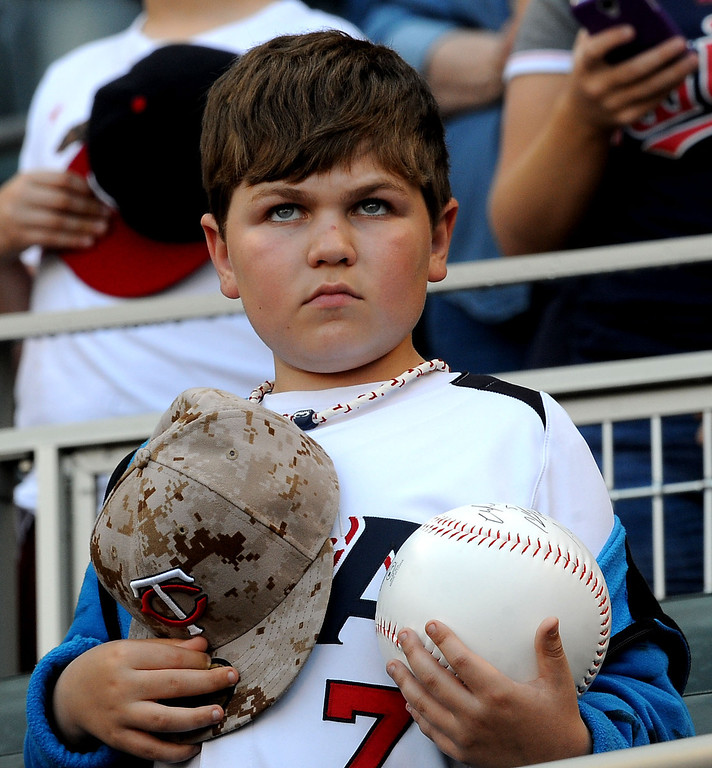 . A Twins fan during the National Anthem prior to the start of the game with the Tigers. (Pioneer Press: Sherri LaRose-Chiglo)