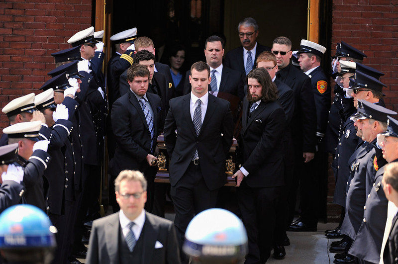 . Firefighters salute as pallbearers carry the casket of Krystle Campbell, a victim of the Boston Marathon bombing, from St. Joseph Catholic Church after a funeral service on April 22, 2013 in Medford, Massachusetts. A manhunt ended for Dzhokhar A. Tsarnaev, 19, a suspect in the Boston Marathon bombing after he was apprehended on a boat parked on a residential property in Watertown, Massachusetts. His brother Tamerlan Tsarnaev, 26, the other suspect, was shot and killed after a car chase and shootout with police. The bombing, on April 15 at the finish line of the marathon, killed three people and wounded at least 170.  (Photo by Kevork Djansezian/Getty Images)