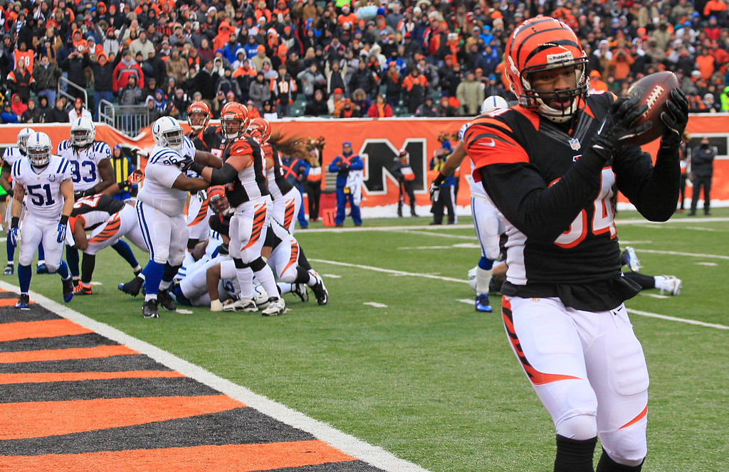 . Cincinnati Bengals tight end Jermaine Gresham (84) catches a 1-yard touchdown pass against the Indianapolis Colts in the second half of an NFL football game, Sunday, Dec. 8, 2013, in Cincinnati. (AP Photo/Tom Uhlman)