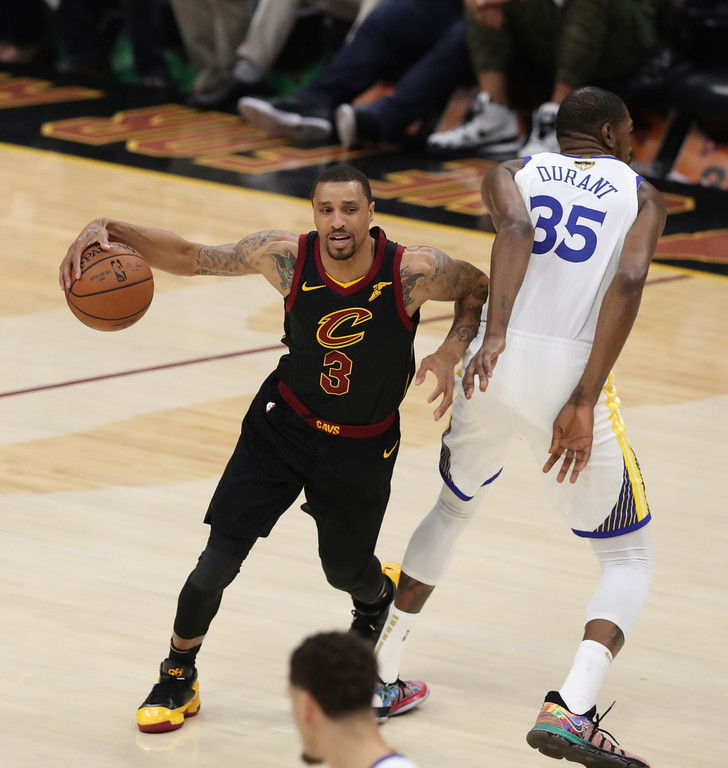 . Cleveland Cavaliers\' George Hill goes around Golden State Warriors\' Kevin Durant in the first half of Game 3 of basketball\'s NBA Finals, Wednesday, June 6, 2018, in Cleveland. (AP Photo/Carlos Osorio)