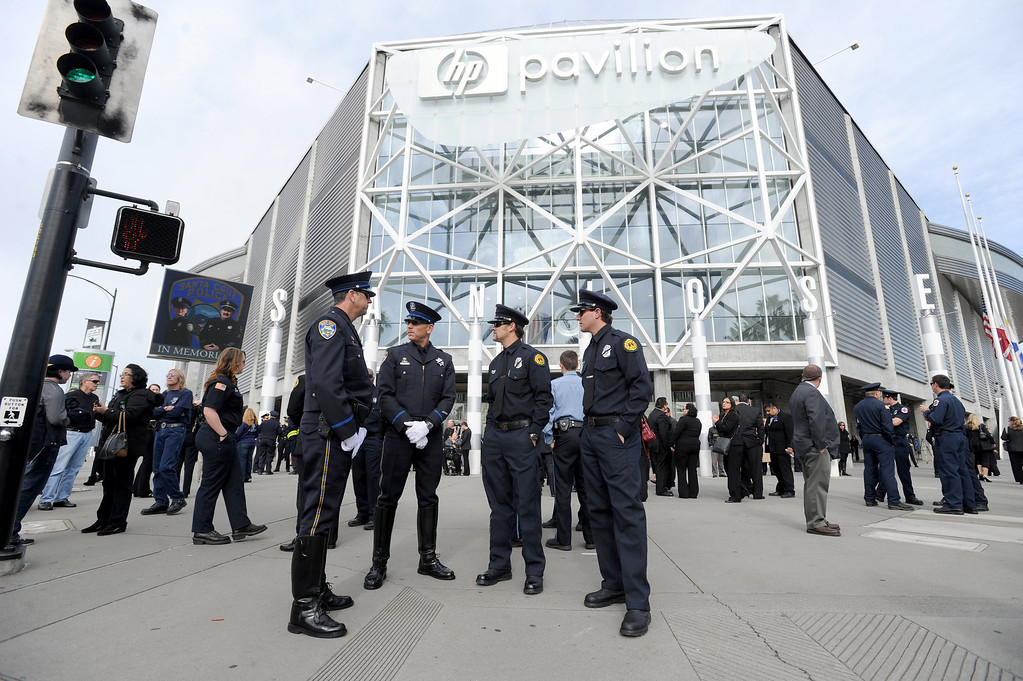 ". Members of the Santa Cruz police and fire departments wait outside at the HP Pavilion in San Jose, Calif. on Thursday, March 7, 2013. Thousands are expected at the pavilion to mourn the loss of the two SantaCruz police officers Loran ""Butch\"" Baker and Elizabeth Butler who lost their their lives in the line of duty on Feb. 26. (Dan Honda/Staff)"