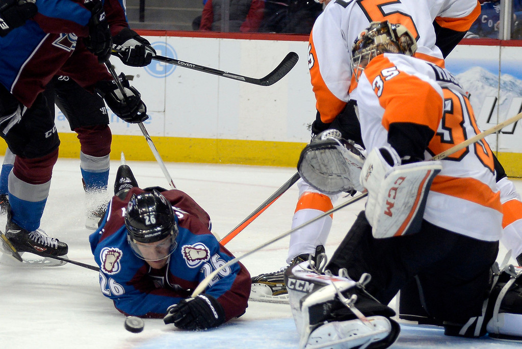 . Colorado Avalanche center Paul Stastny (26) falls to the ice trying to get a shot off on Philadelphia Flyers goalie Steve Mason (35) during the third period January 2, 2014 at Pepsi Center. (Photo by John Leyba/The Denver Post)