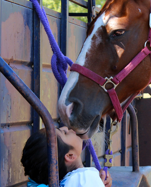 Charra kissing horse 9-13-15 172.jpg