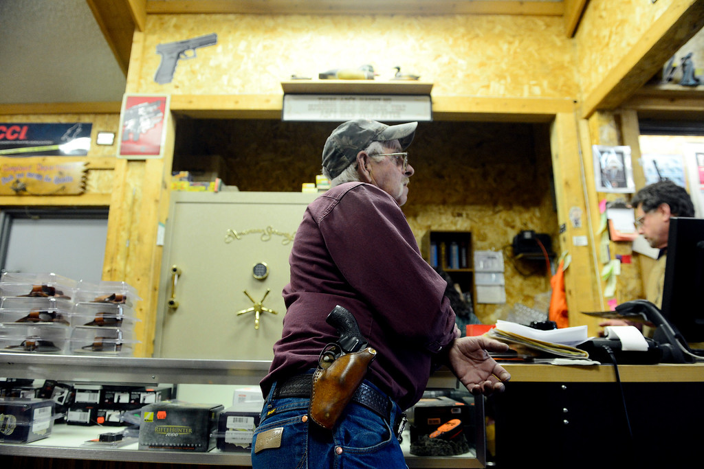 . MONTE VISTA, CO - FEBRUARY 26: Dave Scheel stands with his .38 Smith and Wesson strapped to his hip at Valley Gun in Monte Vista. Gun owners in southern Colorado largely agree that responsible ownership begins at home. (Photo by AAron Ontiveroz/The Denver Post)