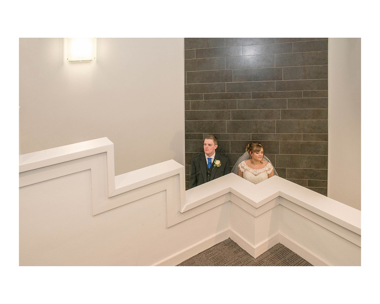 Wedding Photography of Laura & Graham, Stirling Court Hotel, Stirling Universaty, Stirling, Phography is of the Bride & Groom against a wall