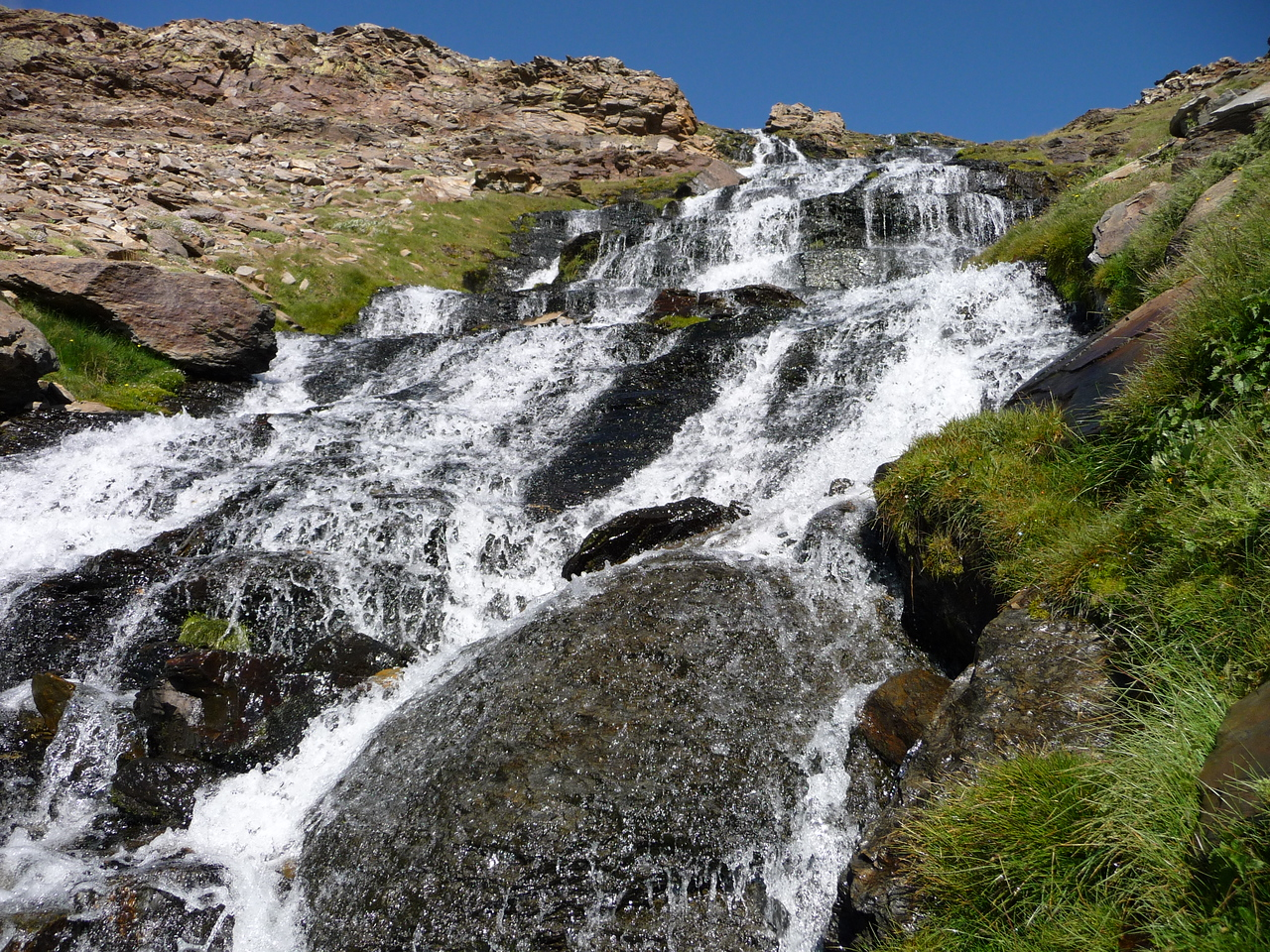 Water from Laguna Hondera at the base of Pico Mulhacen cascading over the Chorreras Negras
