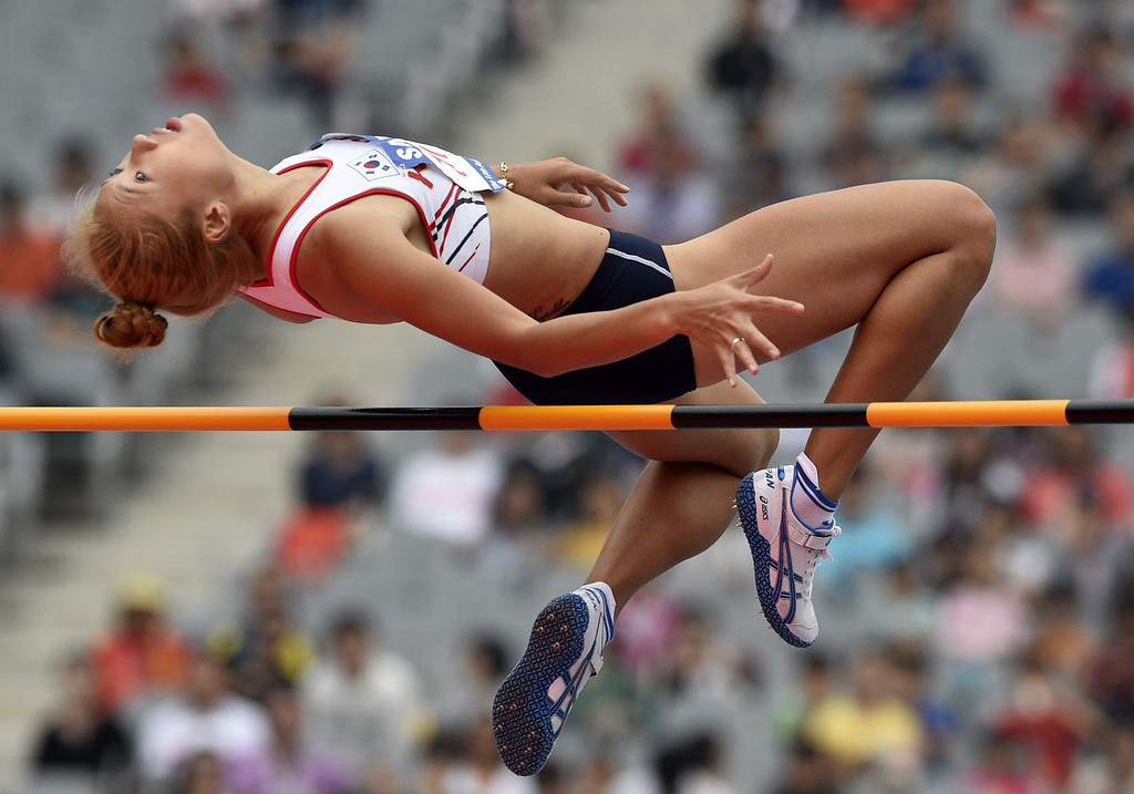. South Korea\'s Jeong Yeonjin competes in the women\'s heptathlon high jump athletics event during the 17th Asian Games at the Incheon Asiad Main Stadium in Incheon on September 28, 2014.  MARTIN BUREAU/AFP/Getty Images