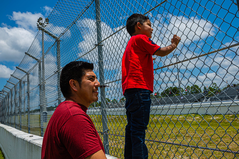 Will Bernal and his son King of Lake Worth watch the drag races at the Super Chevy Show at Palm Beach International Raceway in Jupiter on Saturday, May 25, 2019.[JOSEPH FORZANO/palmbeachpost.com]