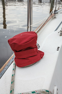 One of four winch covers, with the velcro strap that secures them in place.