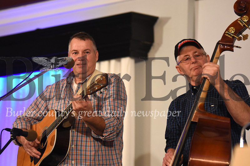 Kelly Hyde (left) and Wes Hardin of Pennsylvania Crude play at Saturday's annual January Ice Jam bluegrass festival at the Days Inn in Butler. Seb Foltz/Butler Eagle