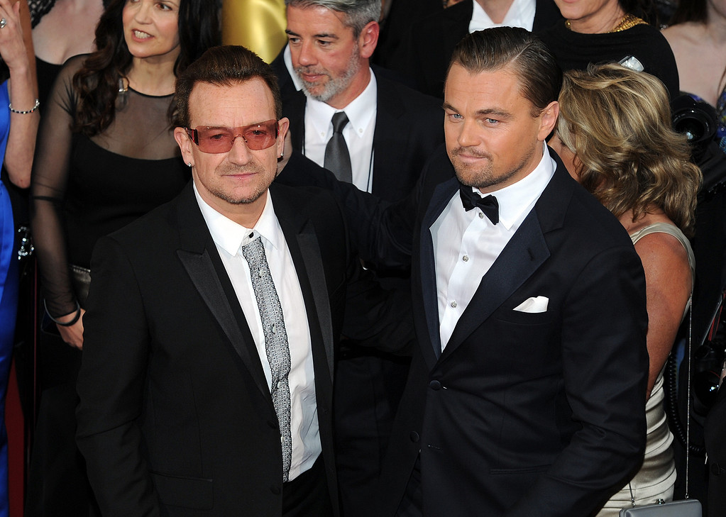 . Bono and Leonardo DiCaprio attend the 86th Academy Awards at the Dolby Theatre in Hollywood, California on Sunday March 2, 2014 (Photo by John McCoy / Los Angeles Daily News)