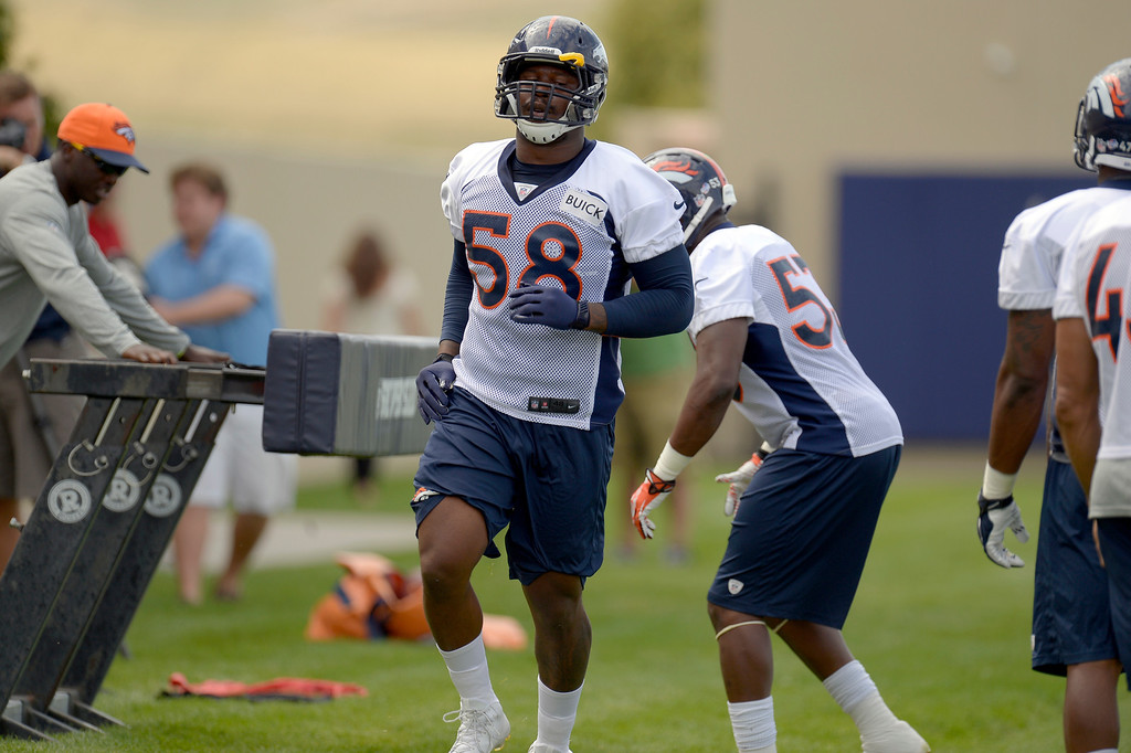 . Denver Broncos outside linebacker Von Miller (58) participates in drills during practice August 23, 2013 at Dove Valley. Miller is suspended for six-games by the league after violating its drug policy. (Photo by John Leyba/The Denver Post)