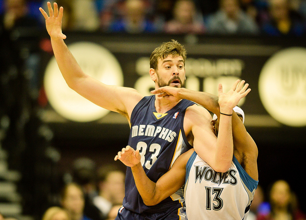 . Memphis Grizzlies center Marc Gasol struggles for position with Minnesota Timberwolves small forward Corey Brewer in the first quarter. (Pioneer Press: Ben Garvin)