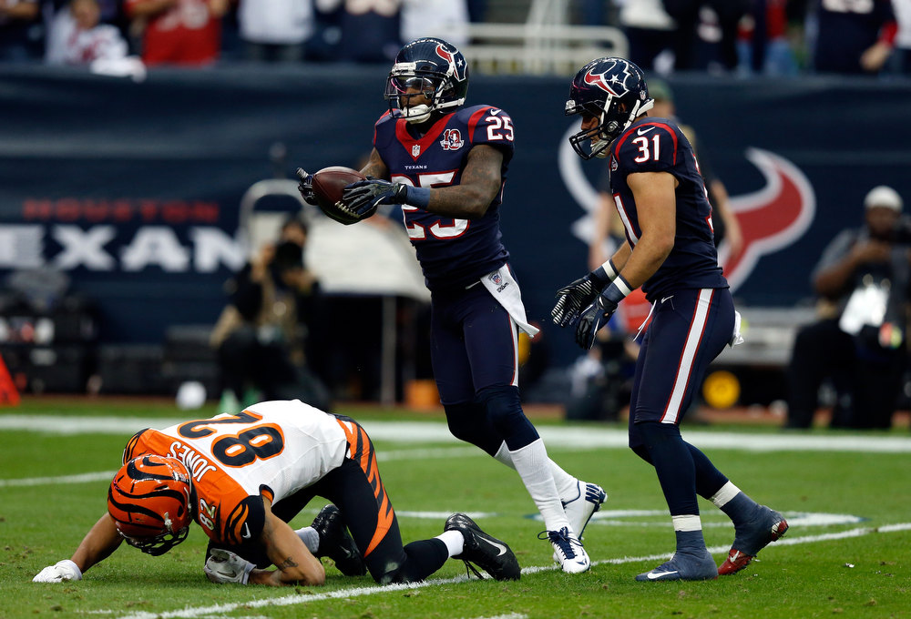 Description of . Kareem Jackson #25 of the Houston Texans reacts against Marvin Jones #82 of the Cincinnati Bengals during their AFC Wild Card Playoff Game at Reliant Stadium on January 5, 2013 in Houston, Texas.  (Photo by Scott Halleran/Getty Images)
