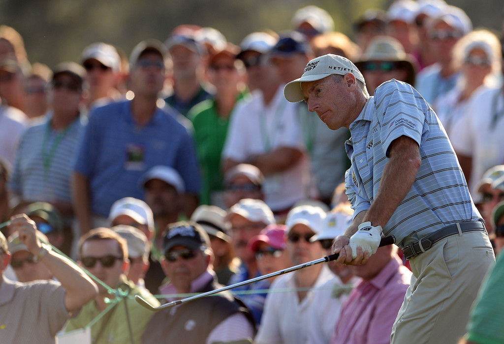. Jim Furyk of the US plays a shot on the 18th green during the third round of the 78th Masters Golf Tournament at Augusta National Golf Club on April 12, 2014 in Augusta, Georgia.       EMMANUEL DUNAND/AFP/Getty Images