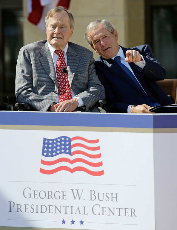 . Former President George W. Bush talks with his father, former President George H. W. Bush, left, during the dedication of the George W. Bush Presidential Center, Thursday, April 25, 2013, in Dallas. (AP Photo/David J. Phillip)