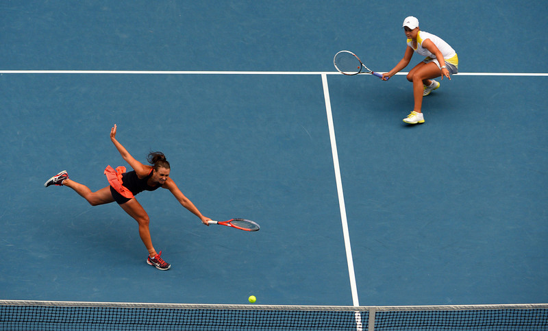 . Ashley Barty of Australia (R) looks on as compatriot Casey Dellacqua plays a return during their women\'s doubles final against Sara Errani and Roberta Vinci of Italy on day twelve of the Australian Open tennis tournament in Melbourne on January 25, 2013.   WILLIAM WEST/AFP/Getty Images