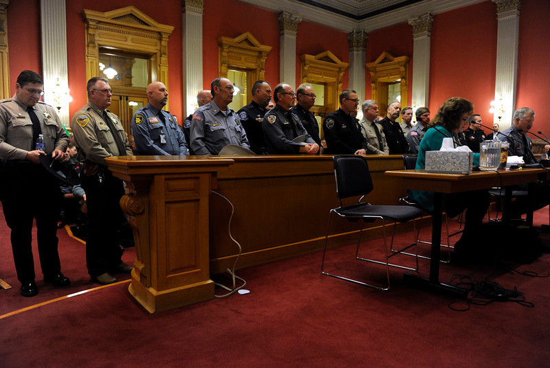 . With over a dozen sheriffs from various Colorado counties standing behind him, Routt County sheriff Garrett Wiggins, right, said he has concerns about unintended consequences of Senate Bill 197 and when asked said he was never consulted about the bill. Testimony begins in front of the Senate Judiciary Committee at the state Capitol for Senate Bill 197 and House Bill 1224. (Photo By Kathryn Scott Osler/The Denver Post)
