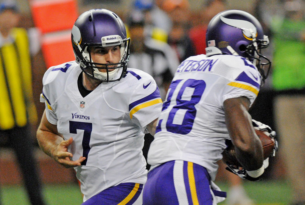 . Vikings quarterback Christian Ponder, left, hands off to running back Adrian Peterson on the first play of the game, which Peterson ran 78 yards for a touchdown against the Lions.  (Pioneer Press: Chris Polydoroff)
