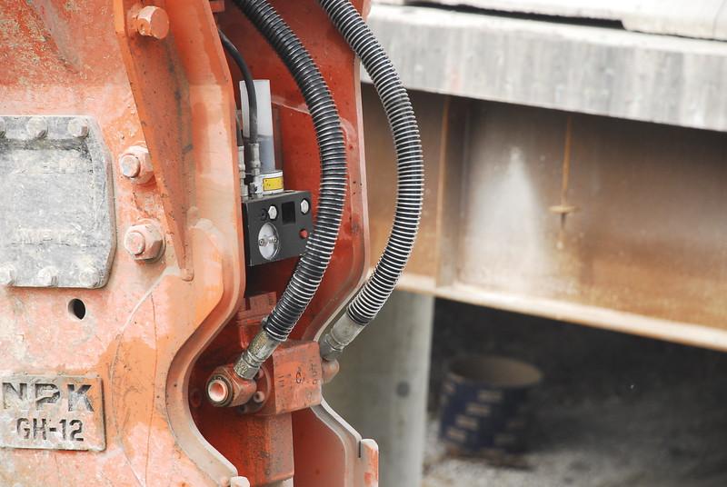 NPK GH12 hydraulic hammer on Cat excavator_bridge demolition (51).JPG