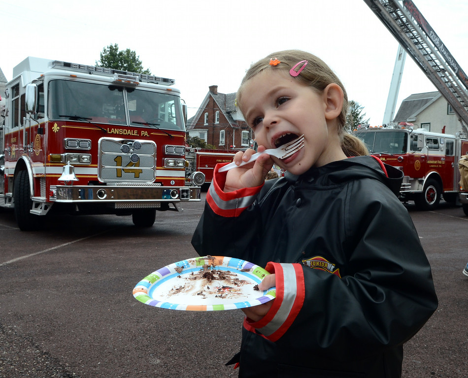 . Esther Cerveny ,3, enjoys a piece of cake for the Fairmount Fire Company 125th Anniversary festivities during the Lansdale Founders Day celebration on Saturday August 23,2014. Photo by Mark C Psoras/The Reporter