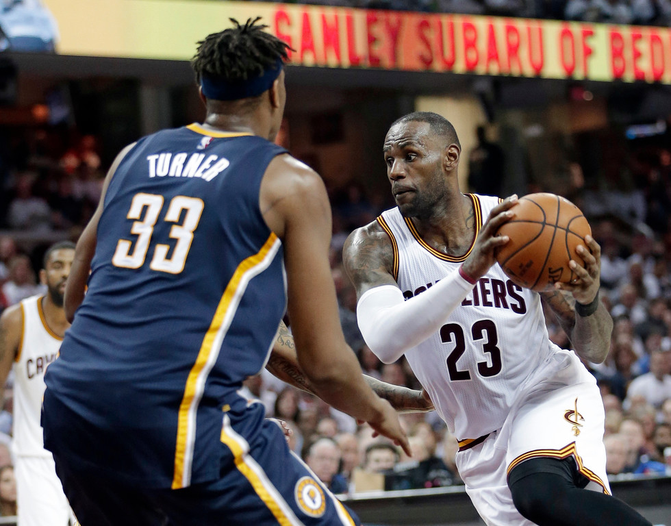 . Cleveland Cavaliers\' LeBron James (23) drives past Indiana Pacers\' Myles Turner (33) in the first half in Game 1 of a first-round NBA basketball playoff series, Saturday, April 15, 2017, in Cleveland. (AP Photo/Tony Dejak)