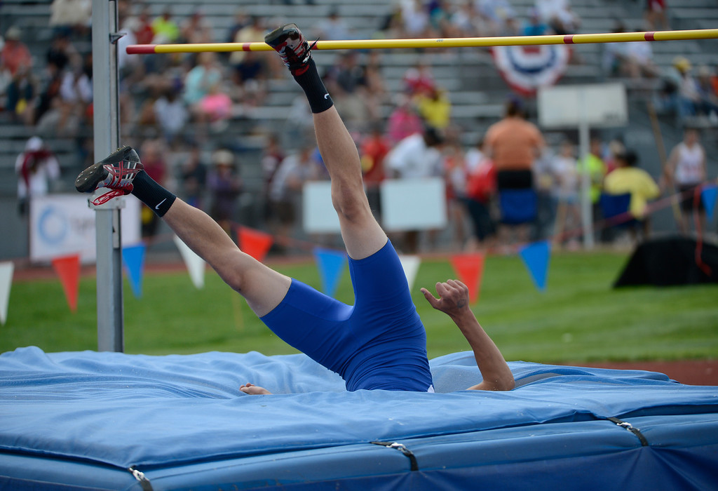 """. LAKEWOOD, CO - MAY 18:  Shane Gates, Cedaredge High School, falls into the pit after trying to clear 6\' 5\"""" during the boys 3A high jump final at the Colorado State Track and Field Championships at Jeffco Stadium, Saturday morning, May 18, 2013. (Photo By Andy Cross/The Denver Post)"""