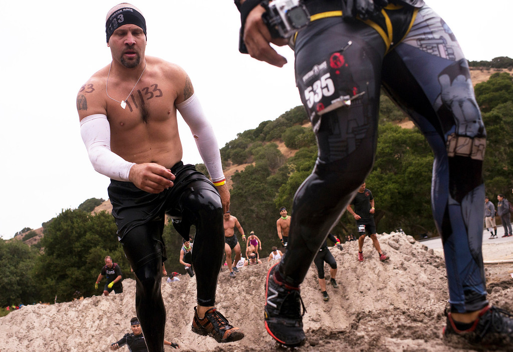 . Kyle Ray powers through through a section of the almost 13 mile Spartan Race course at Toro Park Saturday, August 10th, 2013. (Matthew Hintz/Monterey County Herald)