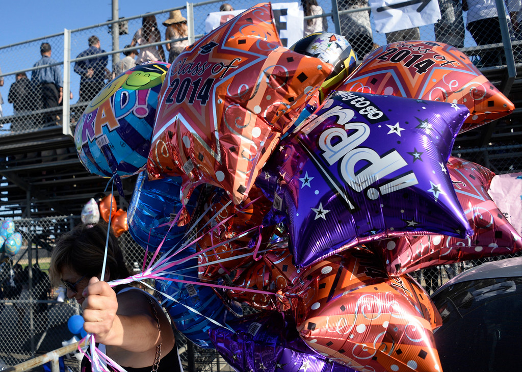 . June 5,2014. North Hills, California. Grad balloons hang on the fence as they were not aloud inside during the Monroe High graduating class of 2014. Photo by Gene Blevins/LA Daily News