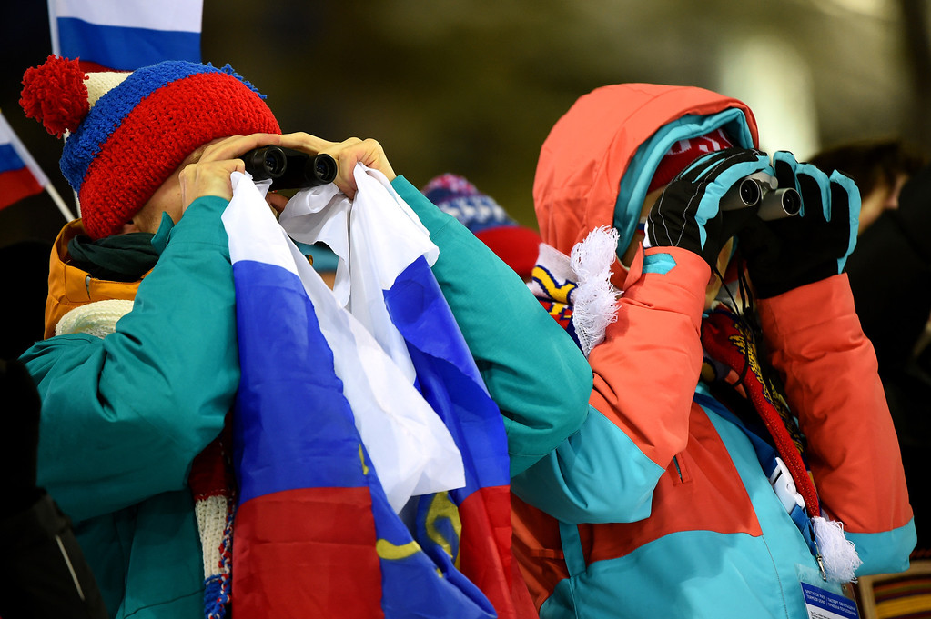. SOCHI, RUSSIA - FEBRUARY 10:  Spectators use binoculars to watch the action during the Men\'s 12.5 km Pursuit during day three of the Sochi 2014 Winter Olympics at Laura Cross-country Ski & Biathlon Center on February 10, 2014 in Sochi, Russia.  (Photo by Lars Baron/Getty Images)