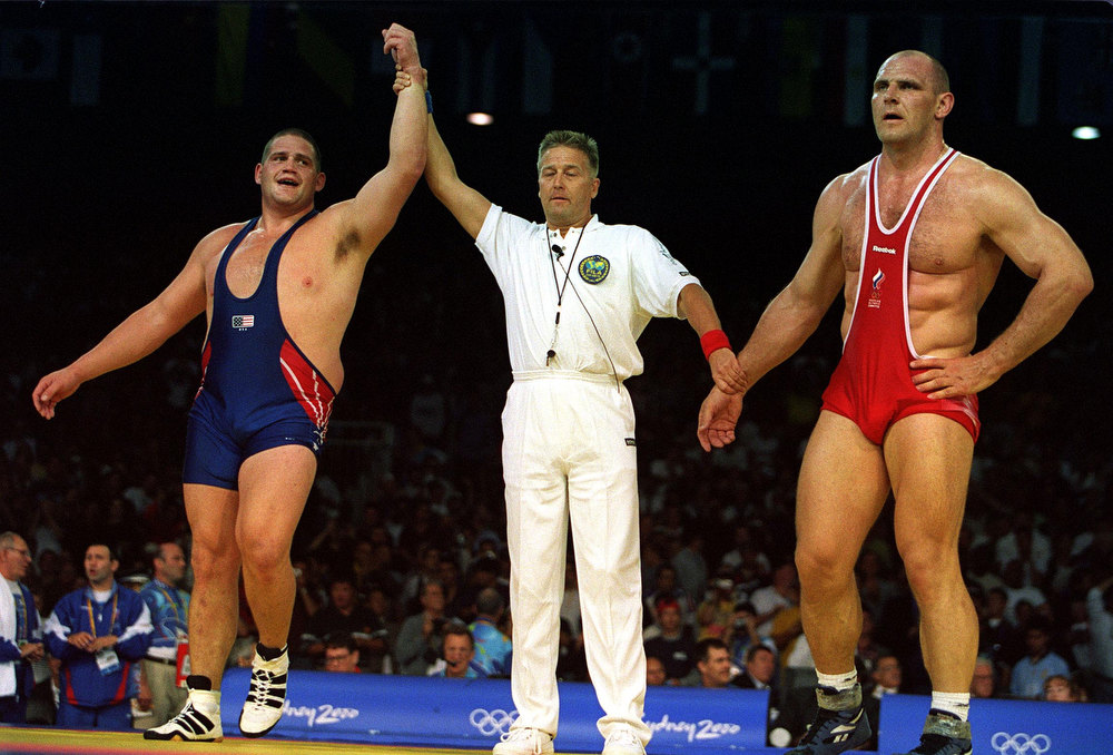 Description of . 27 Sep 2000:  Rulon Gardner of USA (left) celebrates  winning the gold medal by defeating Alexandre Kareline of Russia (right) in the 130  kilogram event during the Greco Roman wrestling held at the Sydney Convention and Exhibition Centre in Darling Harbour during the Sydney 2000 Olympic Games in Sydney, Australia. Mandatory Credit: Billy Stickland/ALLSPORT