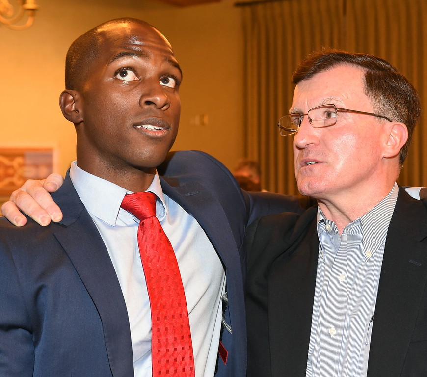 . Tyrone Hampton with his Richard McDonald at Pasadena City Hall on election night. City Council District 1, candidate Tyron Hampton leading Calvin Wells in votes in a close election at city hall on election night.(Photo by Walt Mancini/Pasadena Star-News.)