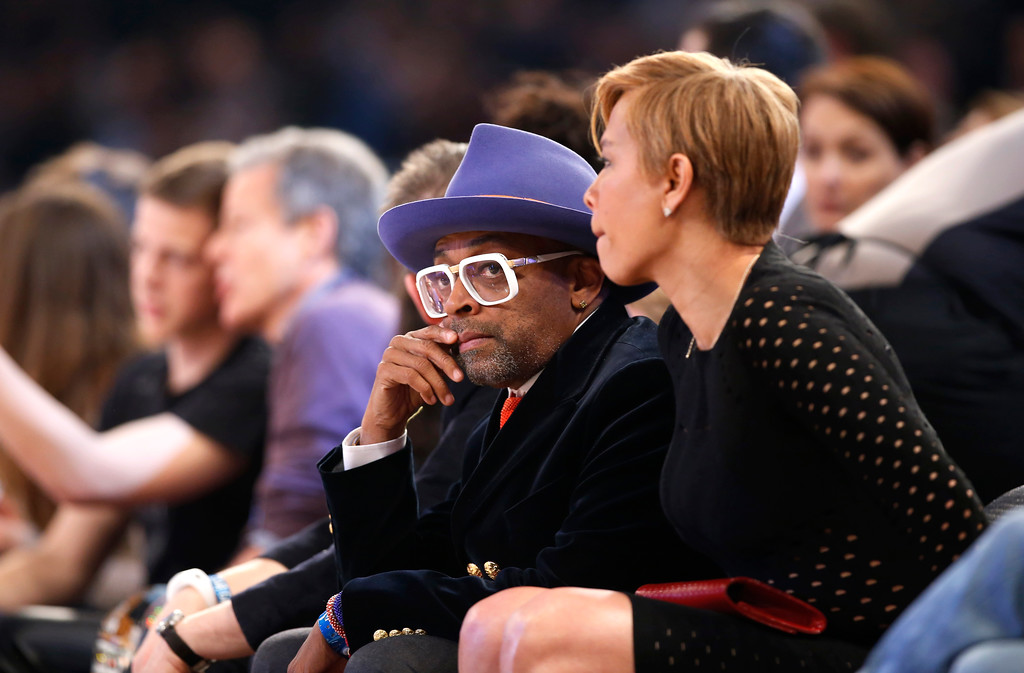 . Spike Lee watches the first half of the NBA All-Star basketball game, Sunday, Feb. 15, 2015, in New York. (AP Photo/Kathy Willens)