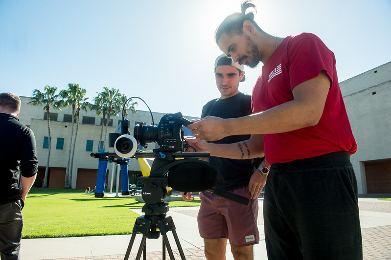 Carlos E. Gonzalez(left) and Alejandro Cano make adjustments as they set up their video camera rig  during professor Nick Manley's film production lab.
