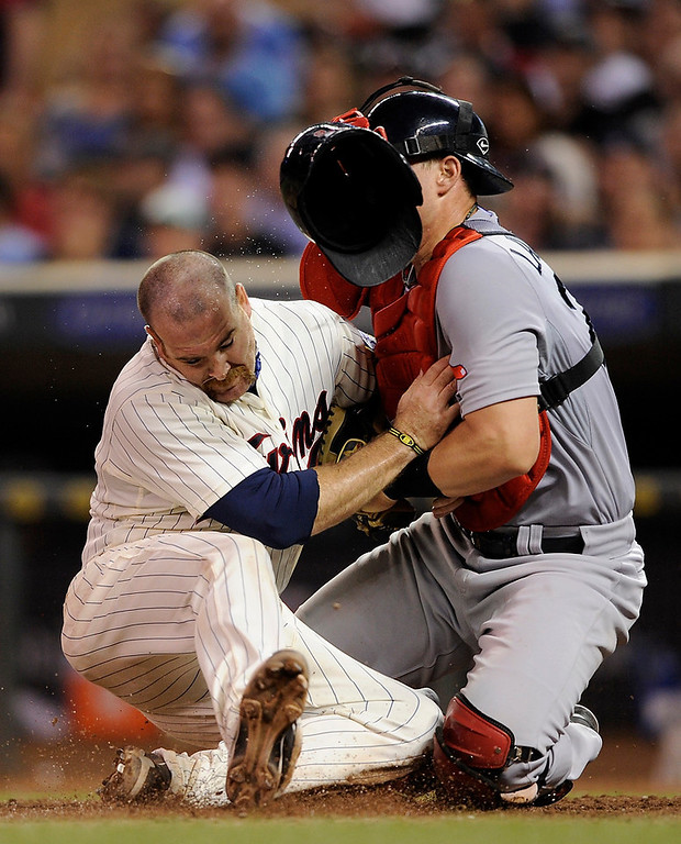 . Ryan Doumit is out at home as Red Sox catcher Ryan Lavarnway hangs onto the ball. (Photo by Hannah Foslien/Getty Images)