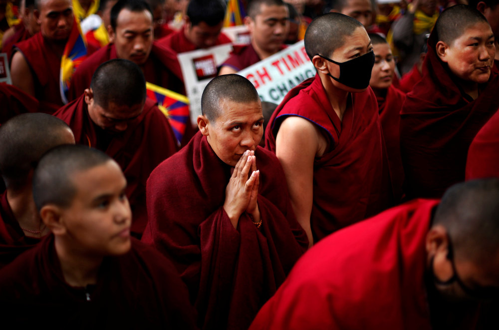 Description of . An exiled Tibetan Buddhist monk prays as he along with others participate in a rally during Tibetan People's Solidarity Campaign in New Delhi, India, Saturday, Feb. 2, 2013. The four-day campaign that began Wednesday is being held to express solidarity with Tibetans inside Tibet and to raise awareness and seek international support for Tibet. (AP Photo/Altaf Qadri)