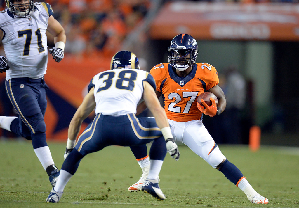 . DENVER, CO. - AUGUST 17: Denver Broncos running back Knowshon Moreno (27) puts a move on St. Louis Rams defensive back Cody Davis (38) during the third quarter August 24, 2013 at Sports Authority Field at Mile High. (Photo By John Leyba/The Denver Post)