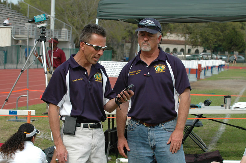 Since I missed the start of Heat 1 of the Girls' Open 1600m . . . I get Holy Trinity Coach Doug Butler to call time off his GameBoy. I snapped this reference shot at 2:00 into the race. Exif time of this shot is 15:28:56. We'll do the math, including for the previous 400m shot. This is fun, follow along. Thanks, Doug!