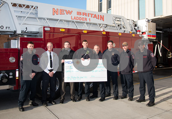 11/20/17 Wesley Bunnell | Staff New Britain Fire Department Local 992 raised $18,648.80 during their Fill the Boot 2017 campaign which concluded with a check presentation to the Muscular Dystrophy Association on Monday afternoon at New Britain Fire Headquarters on Beaver St. FF Pyzik, L, NBFD Chief Peter Margentino, Executive Director for MDA Kevin Cassesse, FF Matt Abdifar, Lt. Coppa, FF Perrotta, FF Choinski and FF Cyr.
