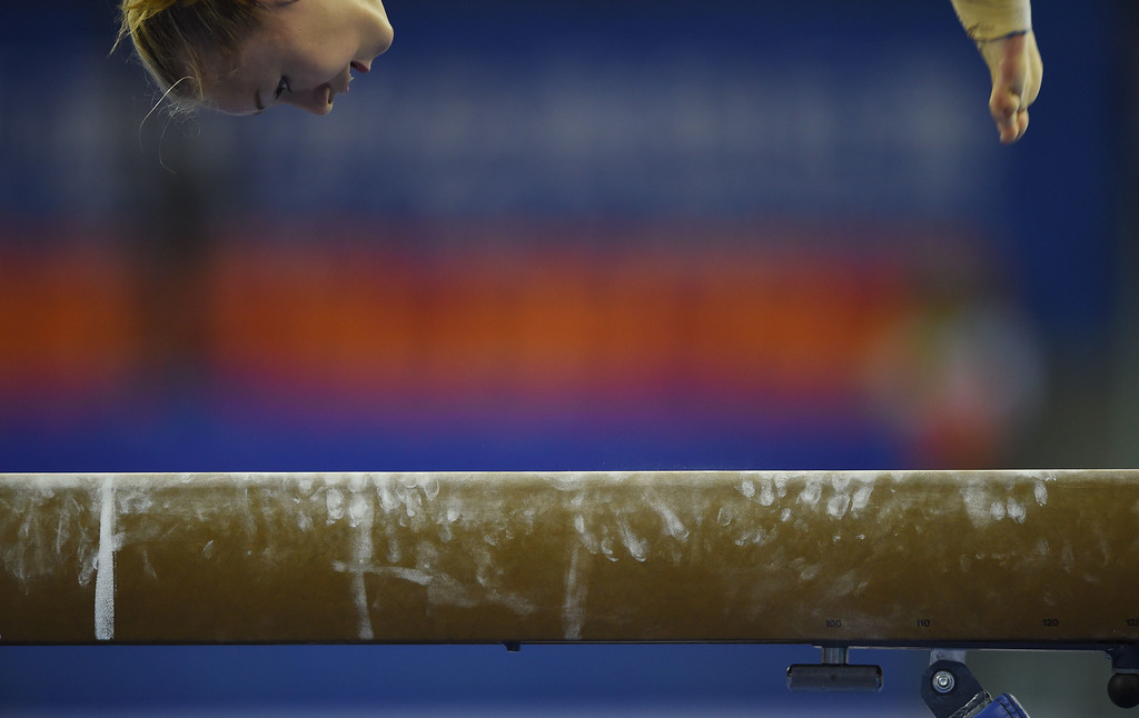. Russia\'s Alla Sosnitskaya warms up on the beam during the women\'s qualification at the Gymnastics World Championships in Nanning, in China\'s southern Guangxi province on October 5, 2014. GREG BAKER/AFP/Getty Images