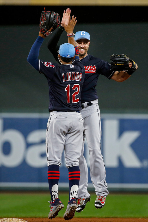 . Cleveland Indians shortstop Francisco Lindor, front, and right fielder Lonnie Chisenhall celebrate the team\'s 6-2 win over the Minnesota Twins in the second baseball game of a doubleheader Saturday, June 17, 2017, in Minneapolis. (AP Photo/Bruce Kluckhohn)