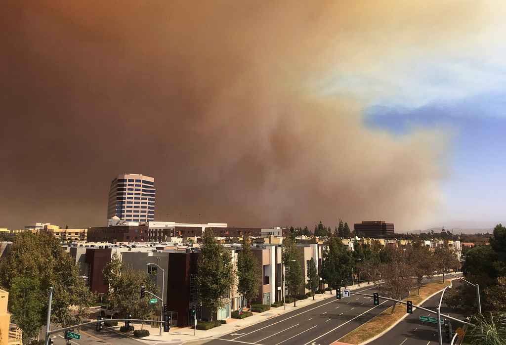 . A large plume of smoke from a brush fire rises over the city of Orange, Calif., on Monday, Oct. 9, 2017. A wildfire has erupted about 45 miles (72 kilometers) southeast of Los Angeles in the hill country of eastern Orange County. The Anaheim Fire Department said the fire erupted late Monday morning. (AP Photo/Chris Carlson)