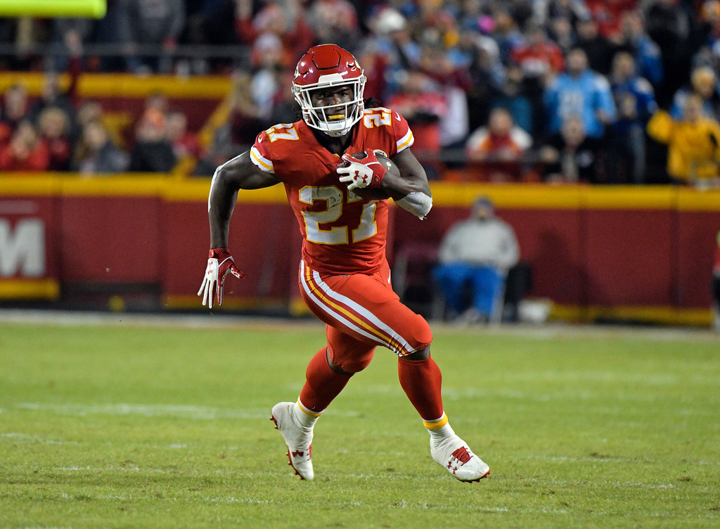. Kansas City Chiefs running back Kareem Hunt (27) carries the ball during the first half of an NFL football game against the Los Angeles Chargers in Kansas City, Mo., Saturday, Dec. 16, 2017. (AP Photo/Ed Zurga)