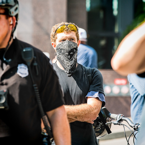 """An anti-fascist makes his presence known to the Trump supporters who gathered for the """"Liberty or Death"""" rally in Seattle. He would later be arrested for assaulting a Trump supporter."""